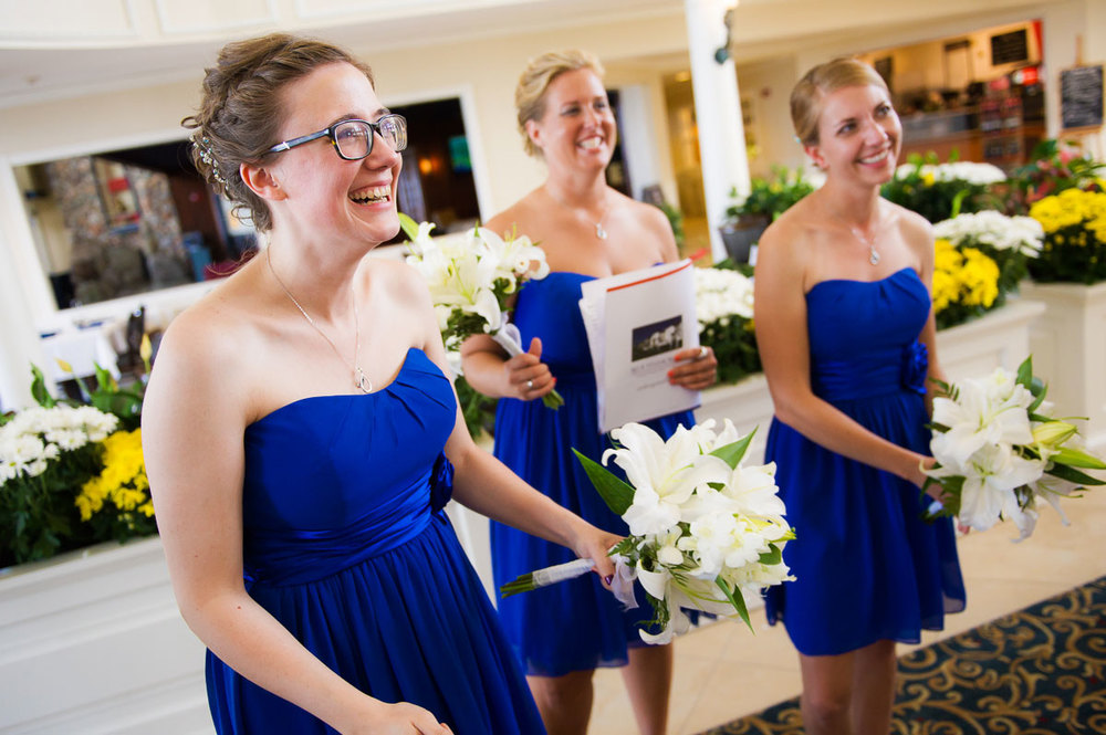 The bridesmaids can hardly contain their excitement after a wedding ceremony at Blue Harbor Resort in Sheboygan, Wisconsin.