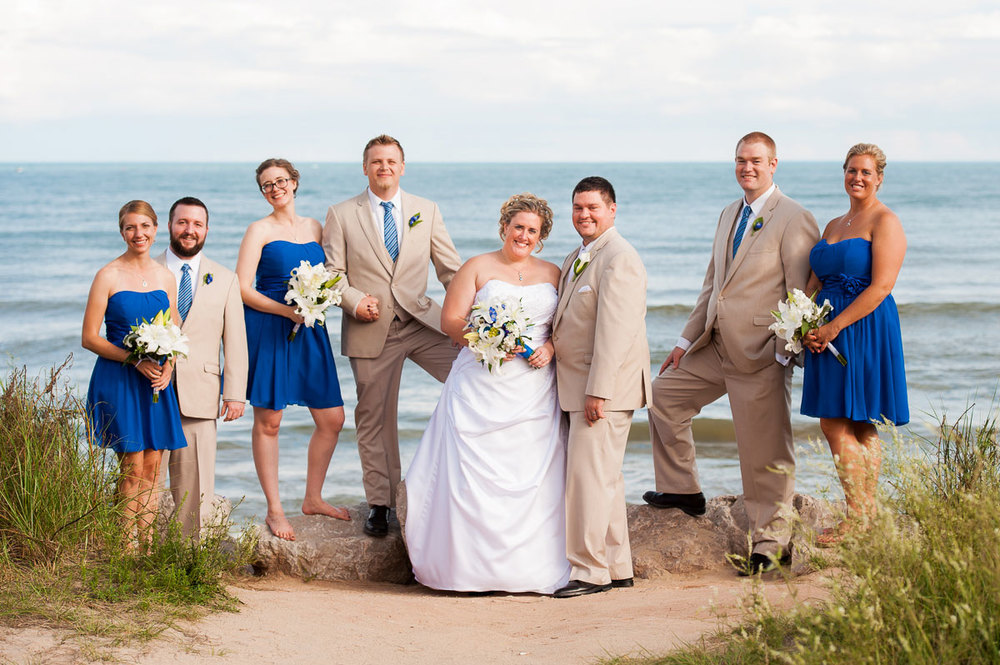 Bridal party on the shores of Lake Michigan at Blue Harbor Resort.