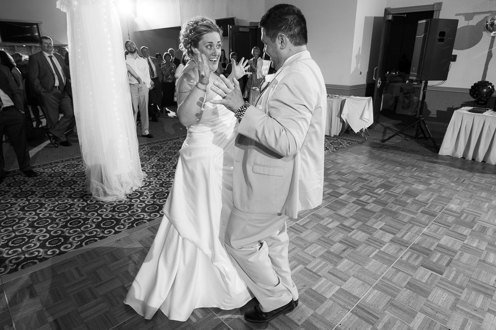 The couple's first dance during their wedding reception at Blue Harbor Resort.