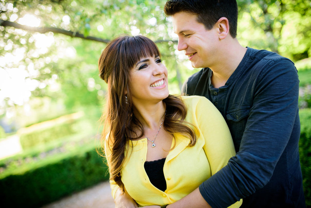 Couple embraces during their engagement session at the Morton Arboretum in Lisle, IL.