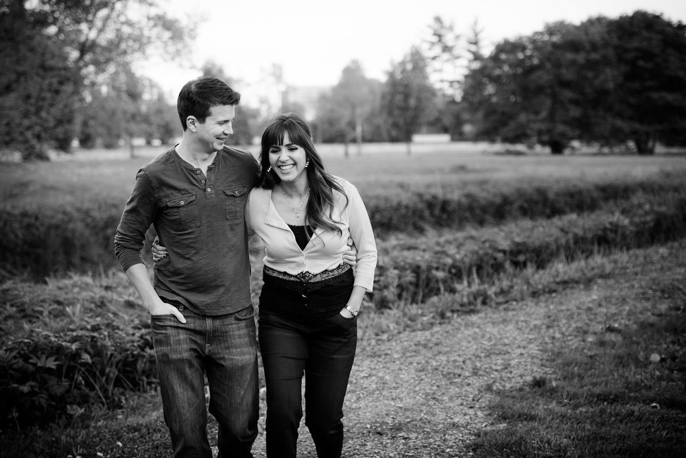 A couple takes a walk during their engagement session at the Morton Arboretum in Lisle, IL.