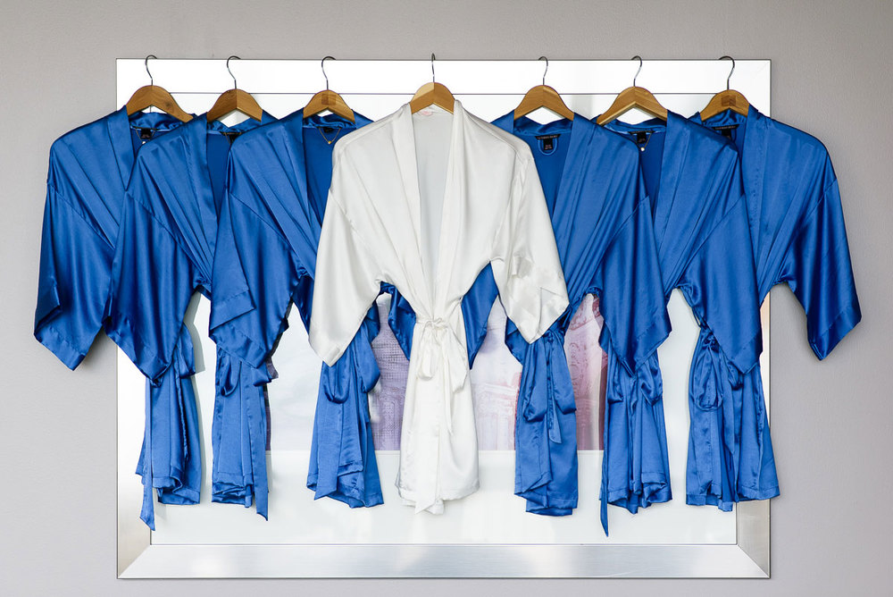 Bride & bridesmaids matching robes on the wedding day at the Trump Tower Chicago.