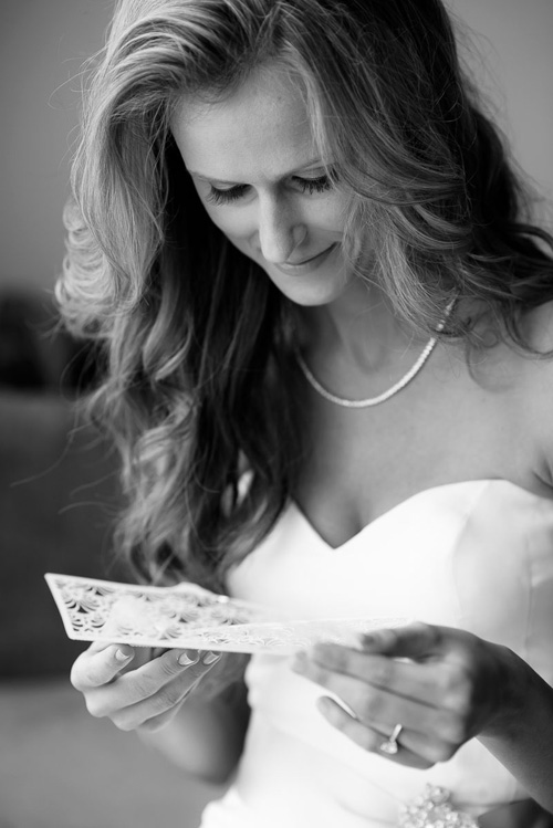 Bride reads a note from her fiancé on her wedding day at the Trump Tower Chicago.