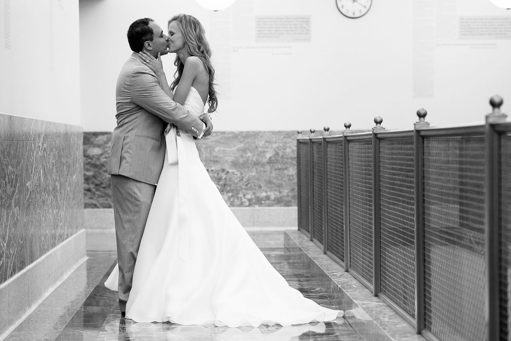 The new couple kisses after their wedding ceremony at the Harold Washington Library Chicago.