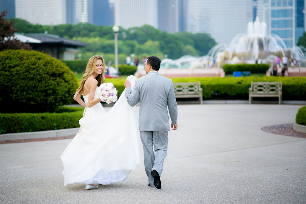 Bride and groom take a walk together during their wedding photos at the Tiffany Gardens in Chicago.