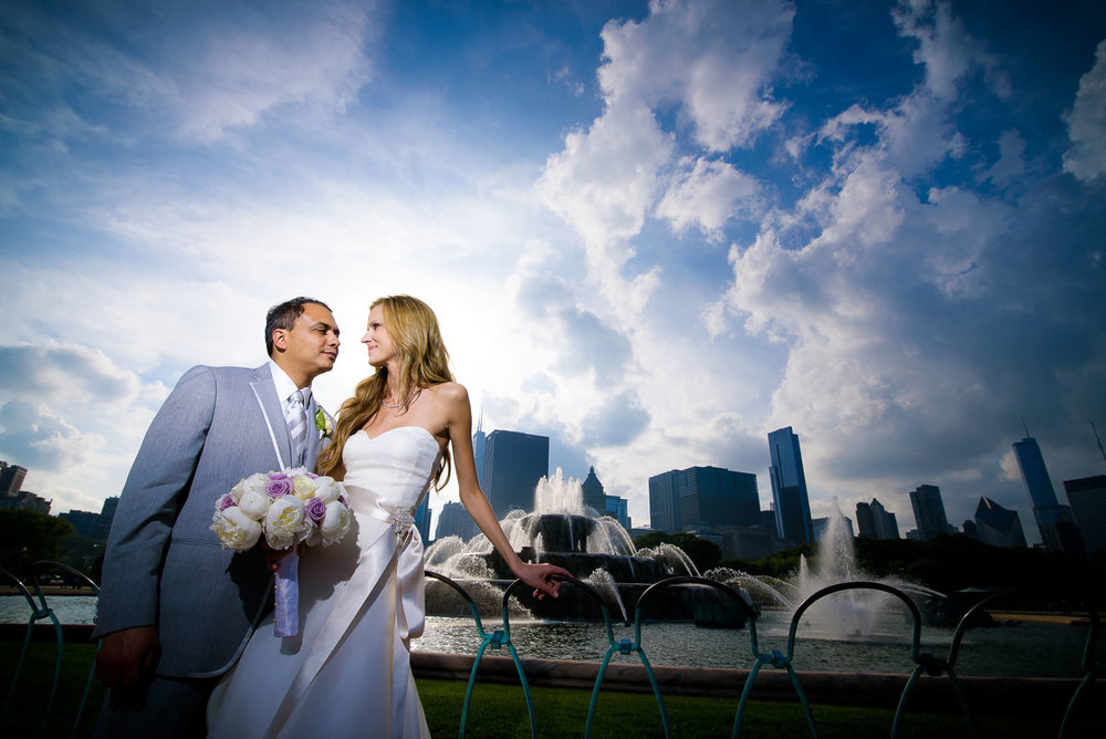 Creative bridal portrait at Buckingham Fountain in Chicago.