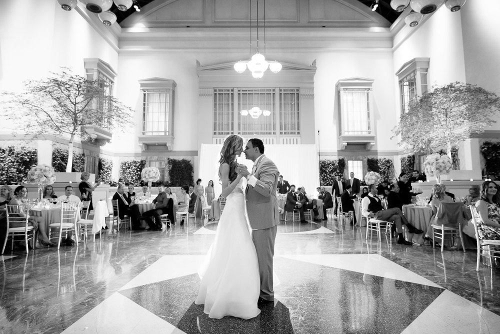 Couple's first dance during their wedding at the  Winter Garden in the Harold Washington Library Chicago.