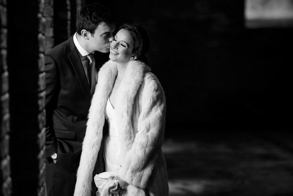 Bride & groom kiss in the sculpture garden during their Bridgeport Arts Center wedding.