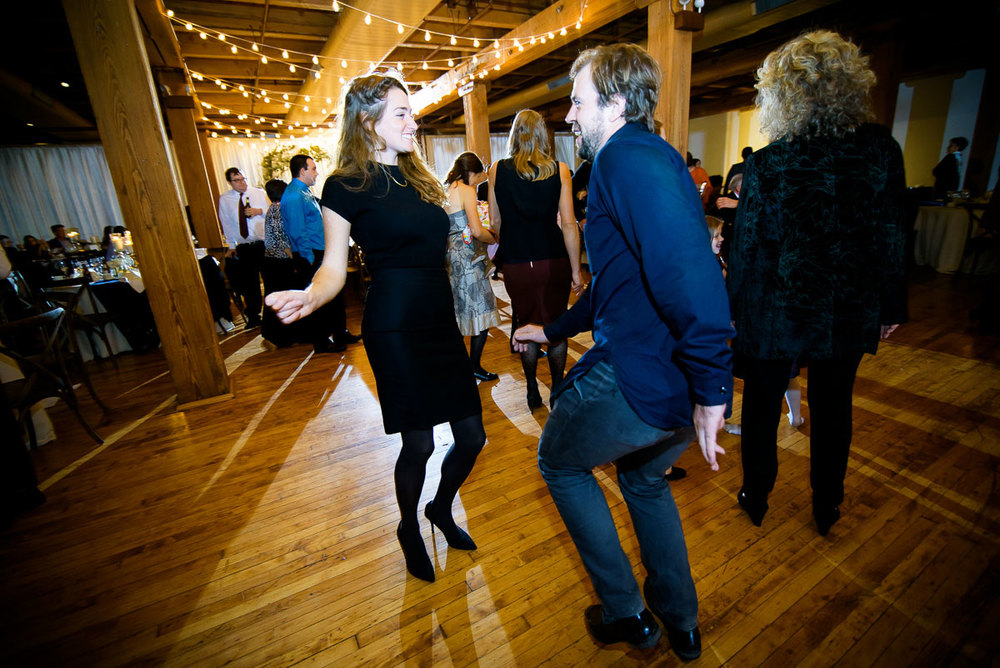 Guests dance during a Bridgeport Arts Center wedding.