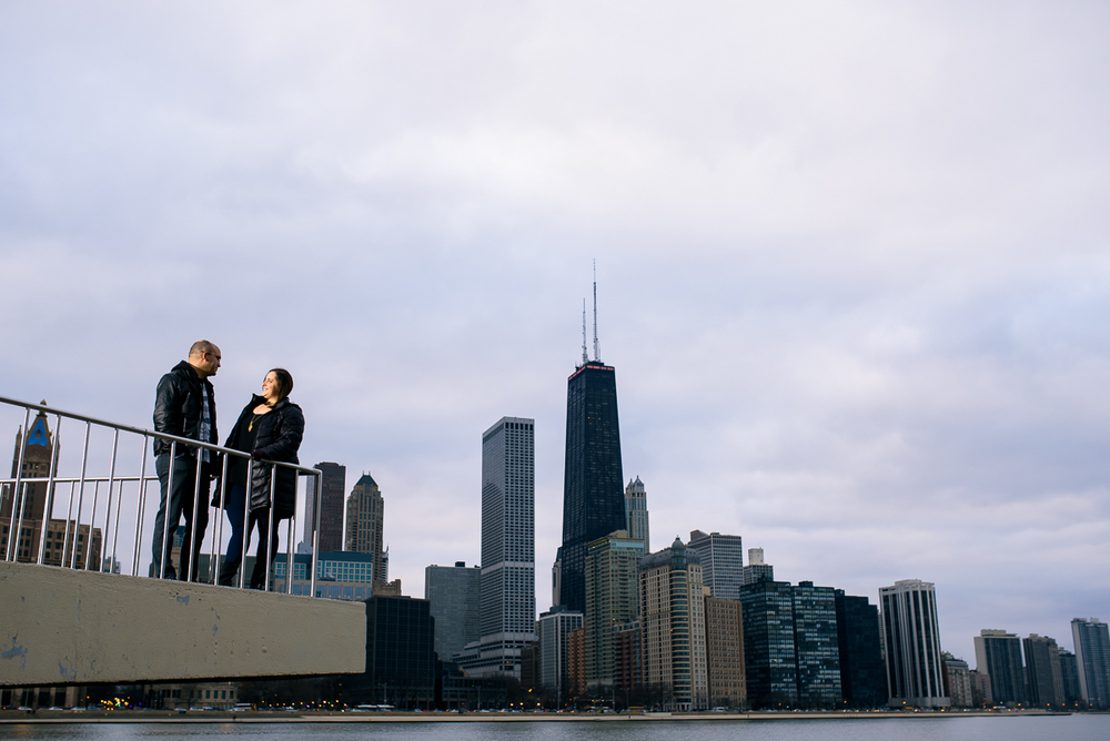 Engagement photo of the couple against the Chicago skyline.