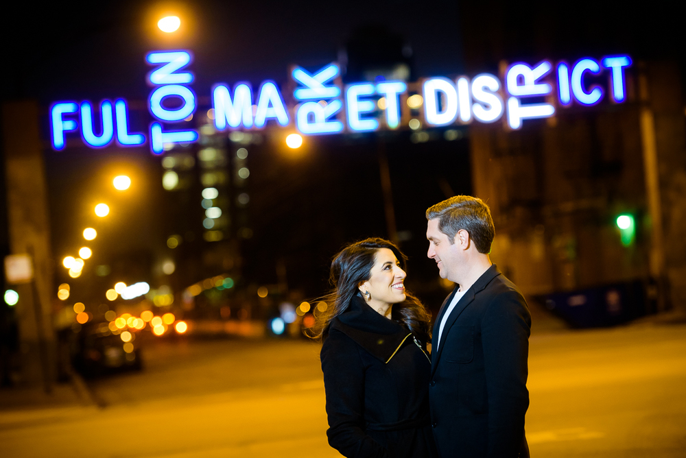 Night portrait in Fulton Market of the couple during their Chicago engagement session.