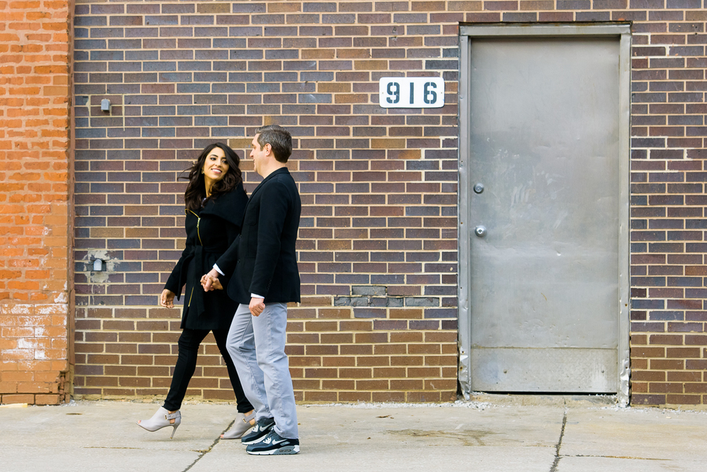 The couple strolls down Fulton Market during their Chicago engagement session.