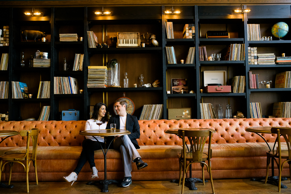 The couple stops for a cocktail at The Betty during their Chicago engagement session in Fulton Market.