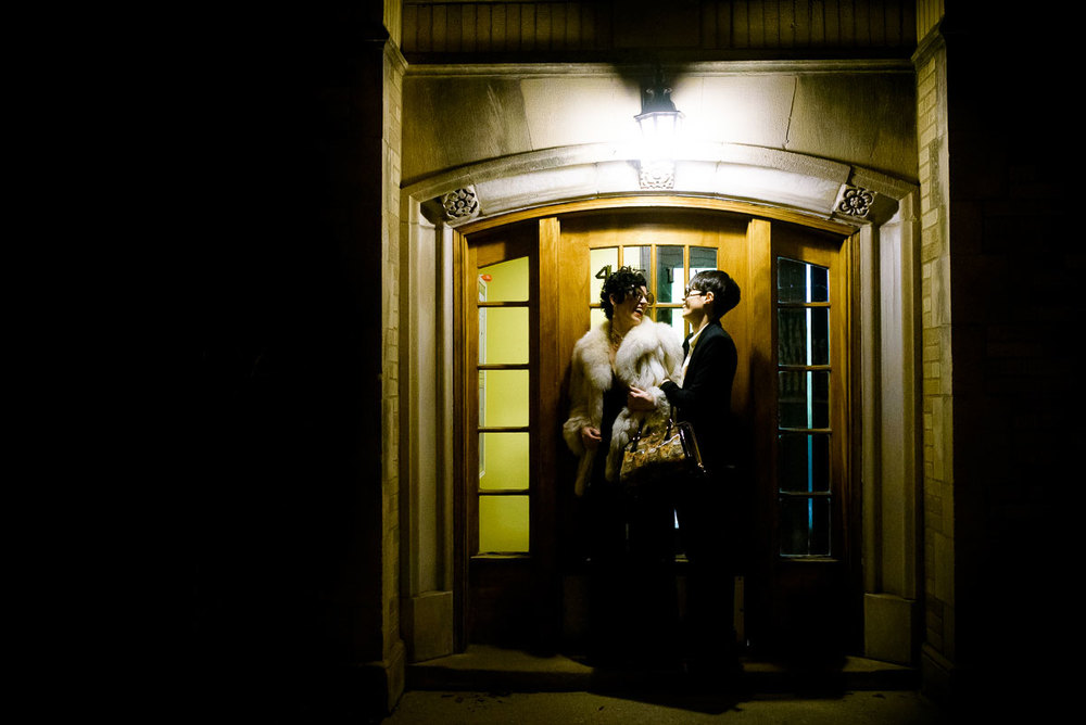 Same sex couple wedding night portrait outside their Lincoln Square apartment.