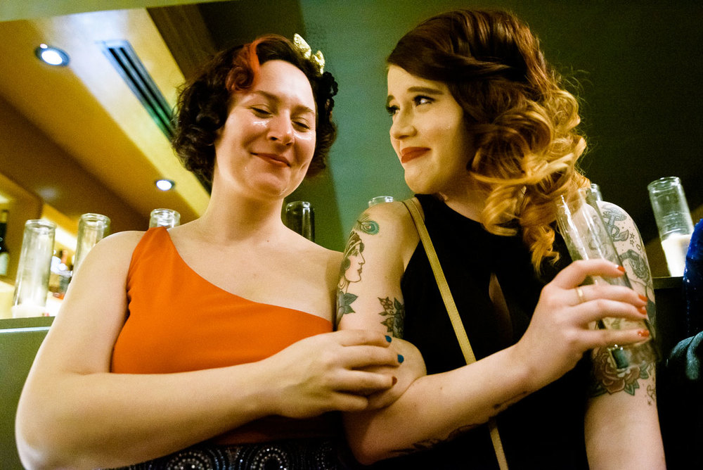 Friends share tears of joy during a same sex wedding ceremony at Tiny Lounge.