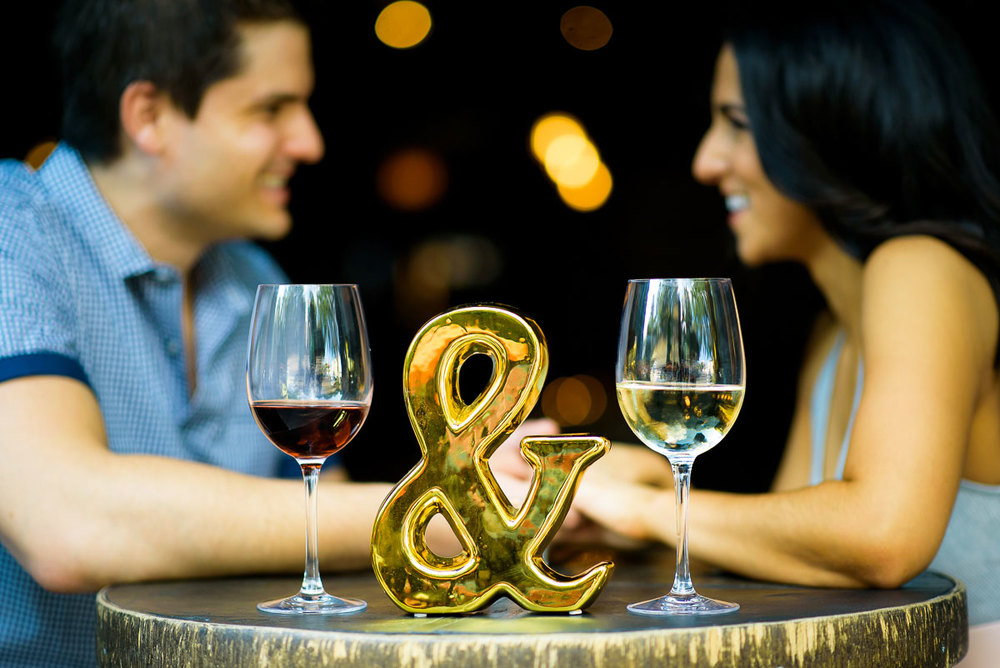 Couple shares a glass of wine at Volo during their Chicago engagement session.