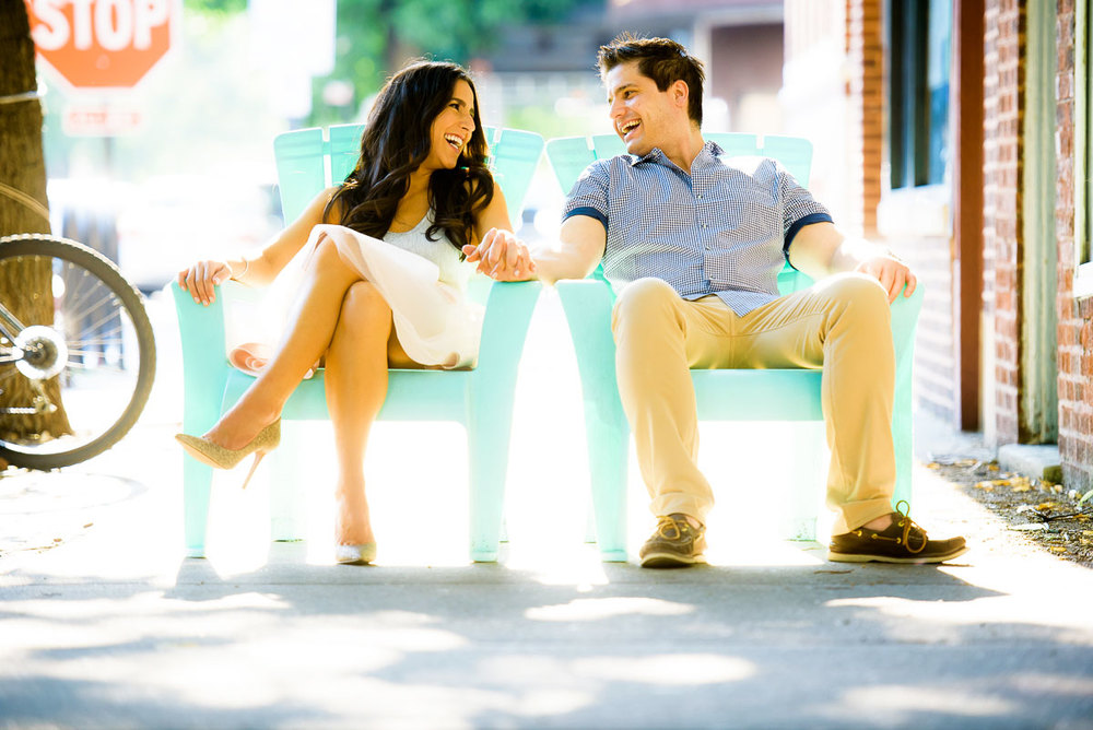 Couple share a laugh in the Roscoe Village Neighborhood during their Chicago engagement session.