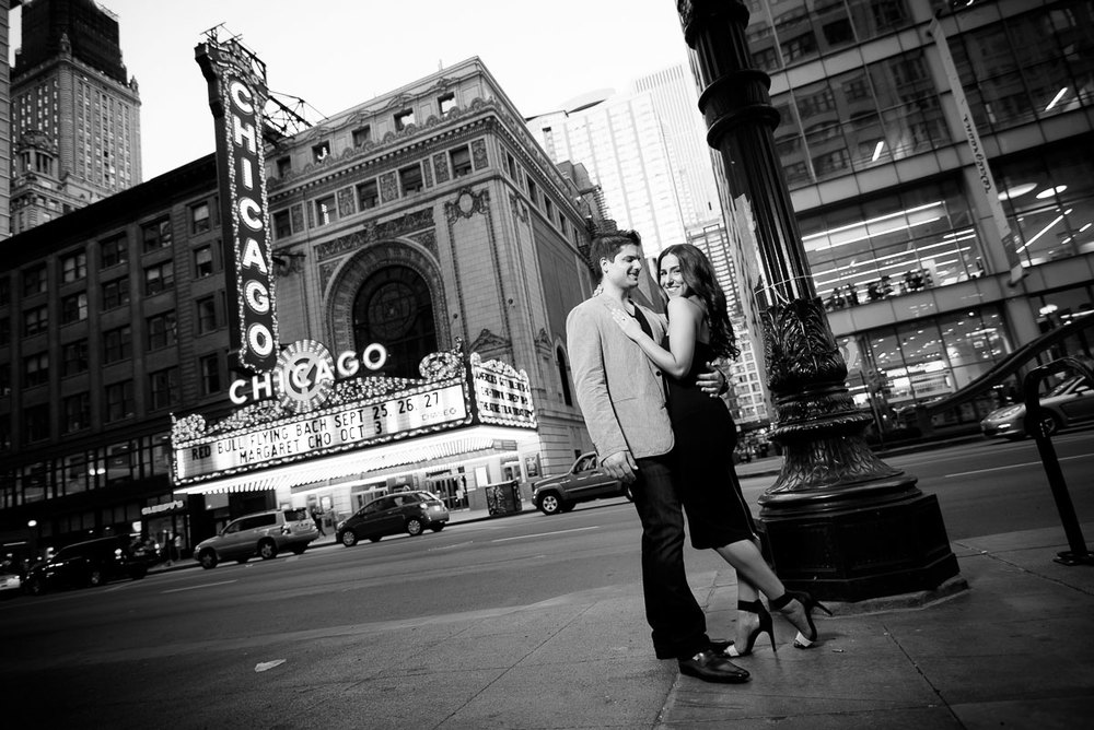 Engagement session outside the Chicago Theater at sunset.
