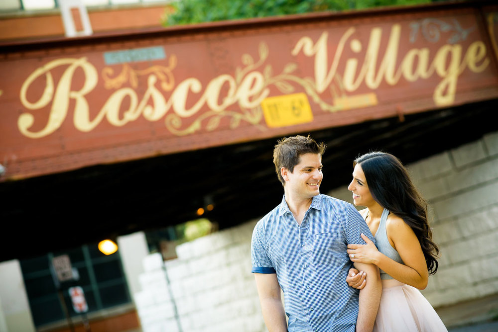 The couple stops by the Roscoe Village viaduct during their Chicago engagement session.