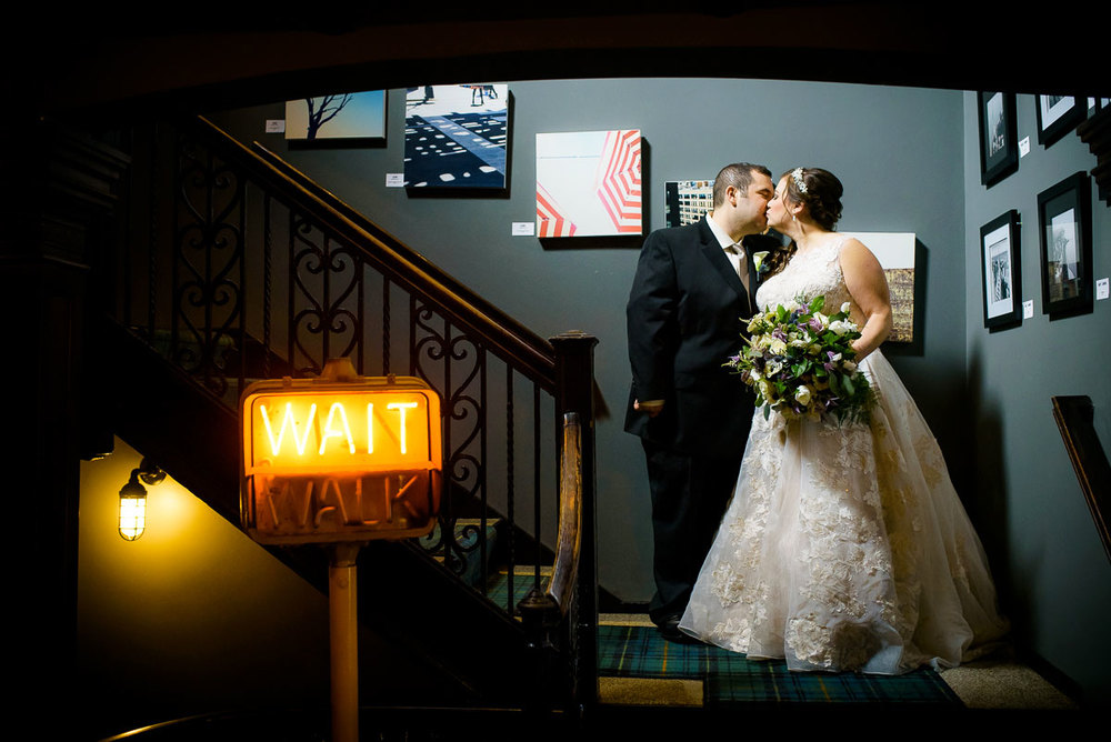 Bride and groom stop for a kiss at The Berkshire Room during their Chicago wedding