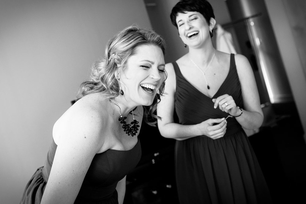 Bridesmaids share a laugh while getting ready at the Sofitel Chicago.