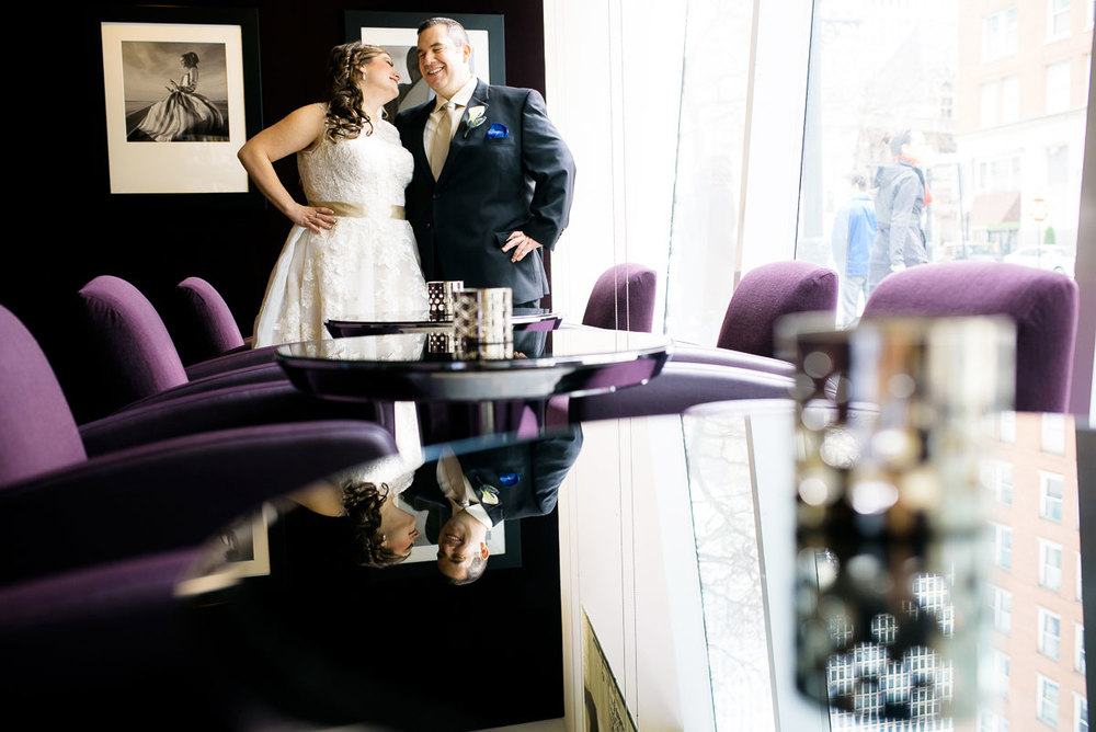 Bride & groom share a laugh at the Sofitel Chicago on their wedding day.