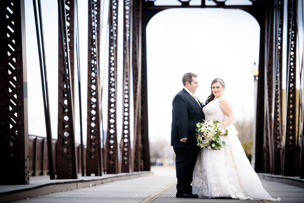 Bridal portrait on the train tracks near Goose Island during their Chicago wedding.