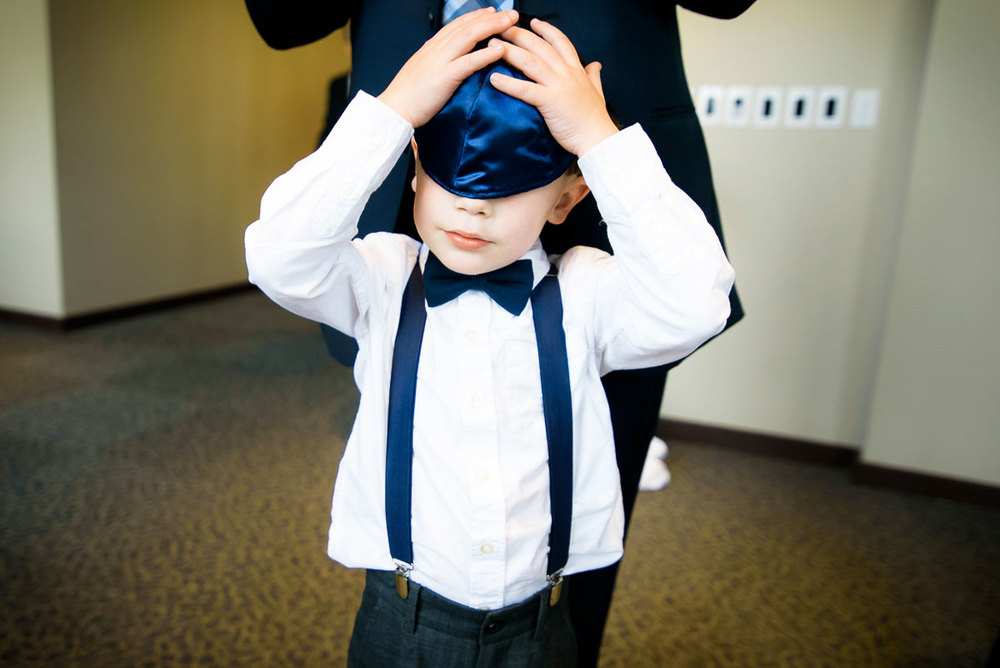 One of the ring bearers has a yamaka mishap on the wedding day at Kendall College.
