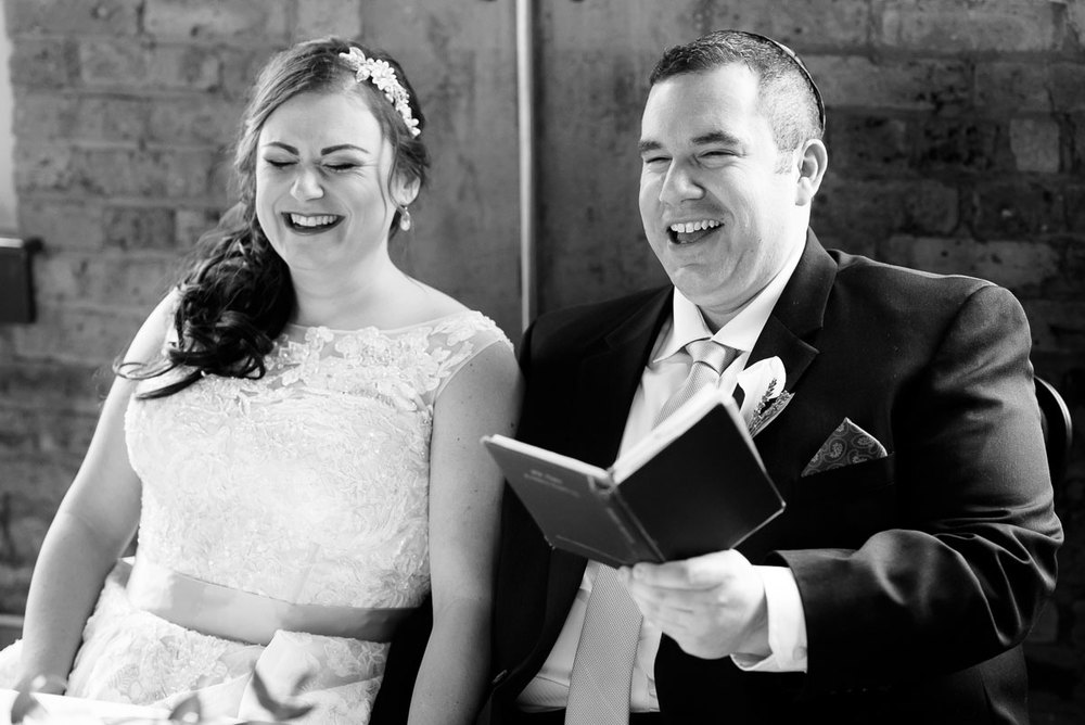 The couple share a laugh during their ketubah signing at Kendall College.