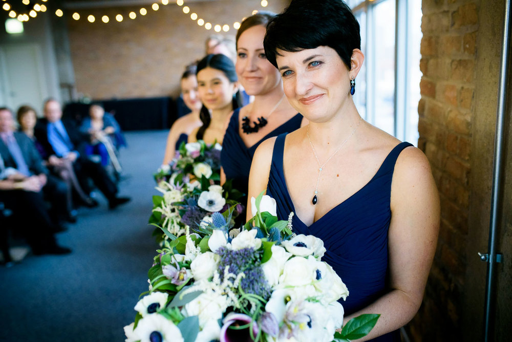 Bridesmaids witness the wedding at Kendall College Chicago.