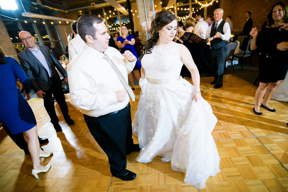 Bride & groom cut loose on the dance floor during their wedding at Kendall College.