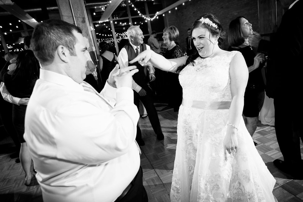 Bride & groom having fun on their wedding day at Kendall College Chicago.