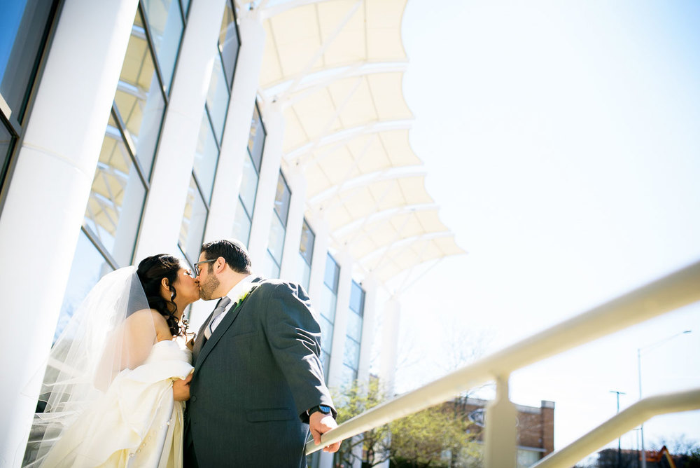 Bride & groom kiss outside the DoubleTree Skokie on their wedding day.