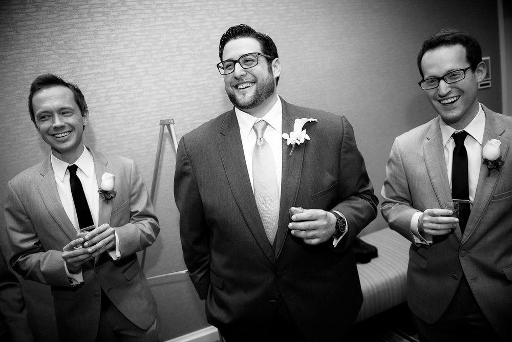 The groom celebrates with his groomsmen during the tisch at the DoubleTree Skokie.