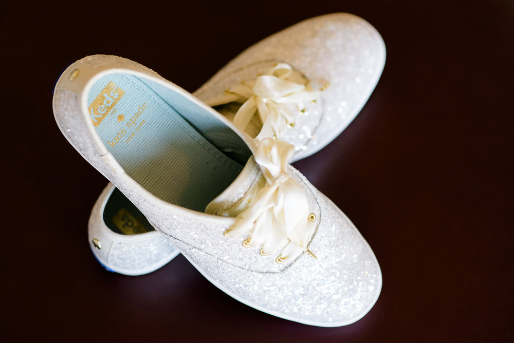 Detail photo of the bride's Keds by Kate Spade on the wedding day at the Thompson Chicago.