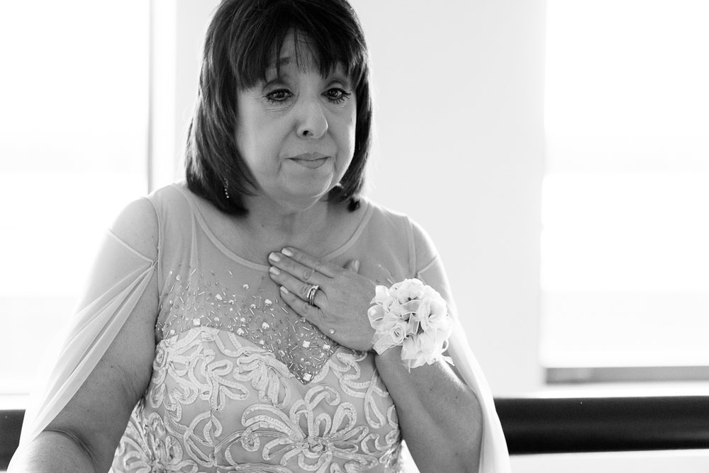 Emotional mother-of-the-bride watches her daughter get ready on the wedding day at the Thompson Chicago.