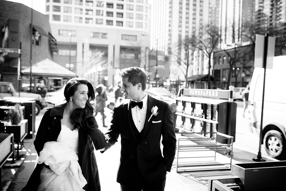 Bride & groom take a stroll through the Gold Coast on their wedding day at the Thompson Chicago.