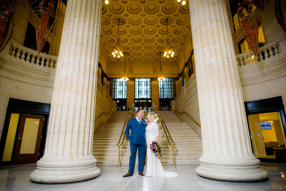 Wedding photo of the bride & groom near the grand staircase at Union Station Chicago.