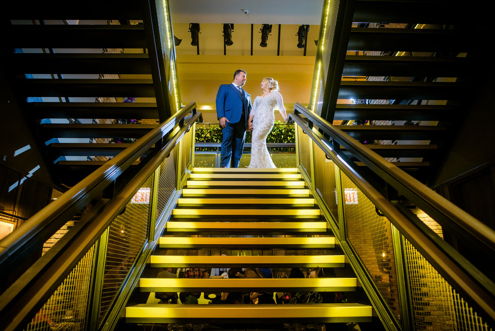 Wedding photo of bride & groom on the grand staircase at the Thompson Chicago.