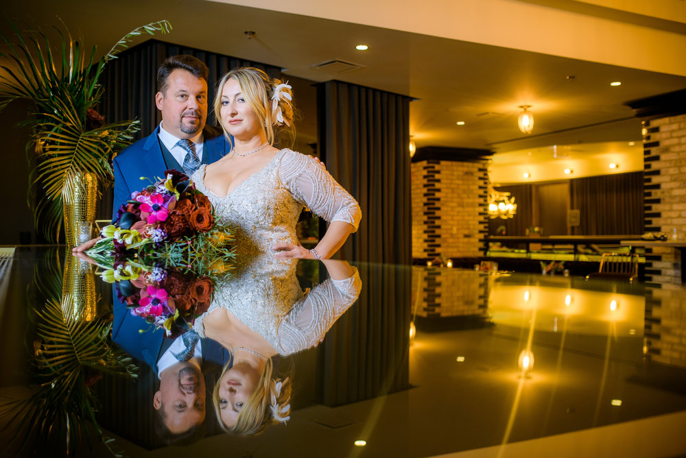Fun, creative wedding photo of bride & groom at the bar of the Thompson Chicago.