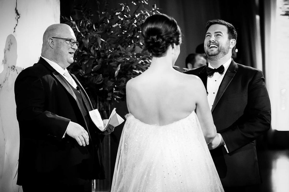 Groom laughs during the wedding ceremony at Moonlight Studios Chicago.