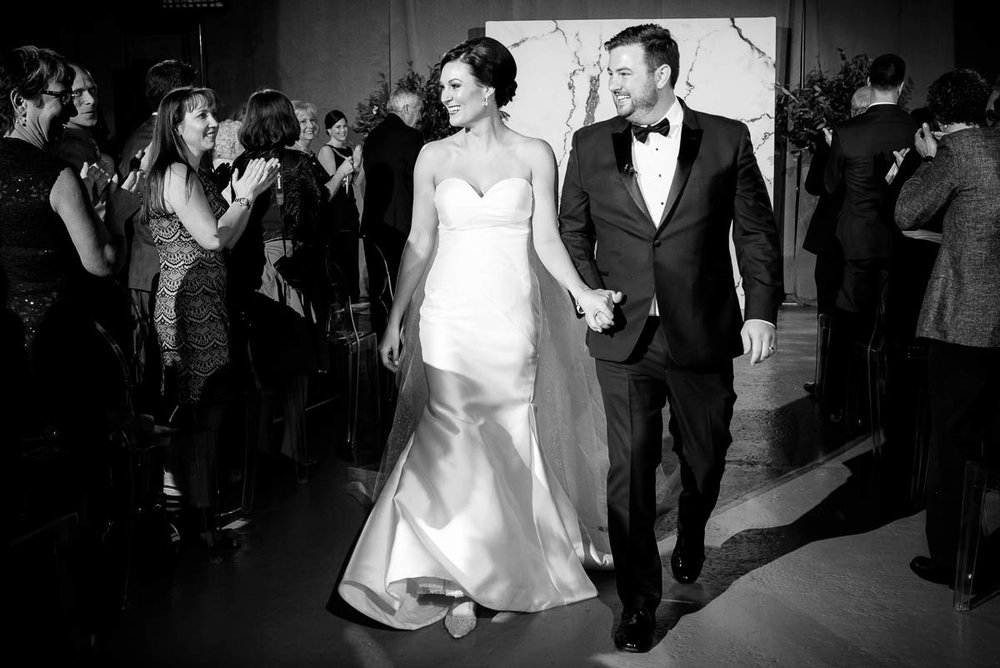 Bride & groom walk down the aisle after their wedding ceremony at Moonlight Studios Chicago.