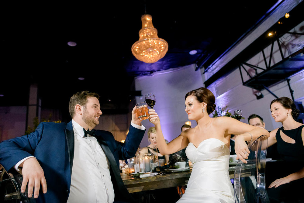 Couple toasts during their Moonlight Studios Chicago wedding.