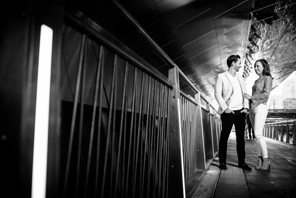 Chicago engagement session under the State St. Bridge along the Riverwalk.
