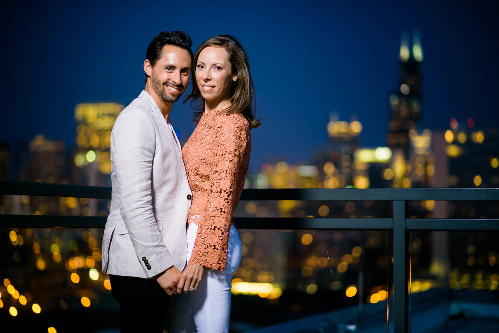 Night portrait with the Willis Tower in the background during a Chicago engagement session.