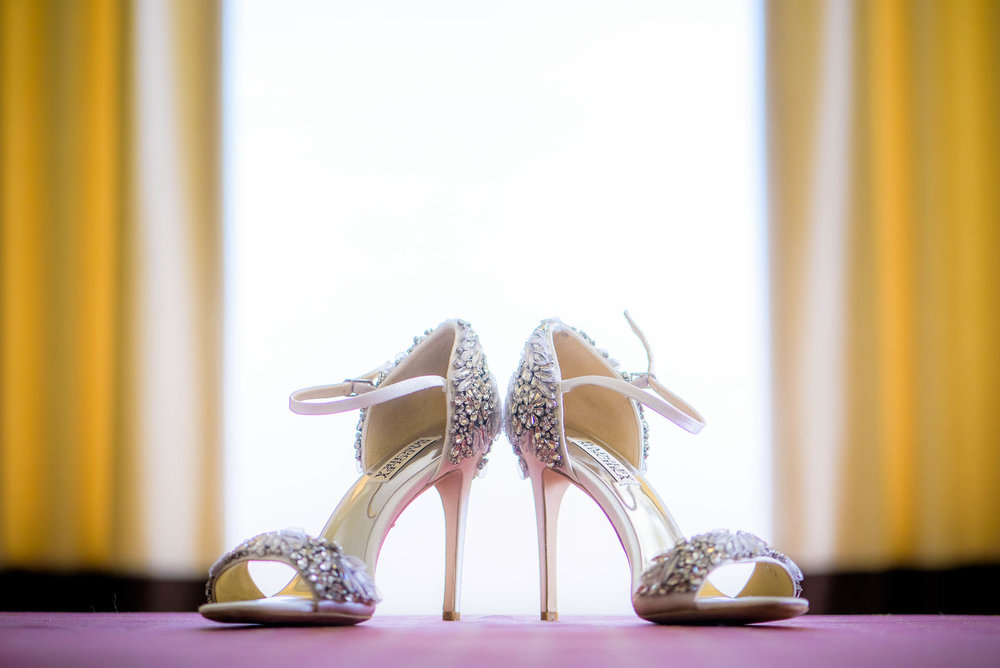 Detail photo of bride's shoes before her Bridgeport Art Center wedding in Chicago.