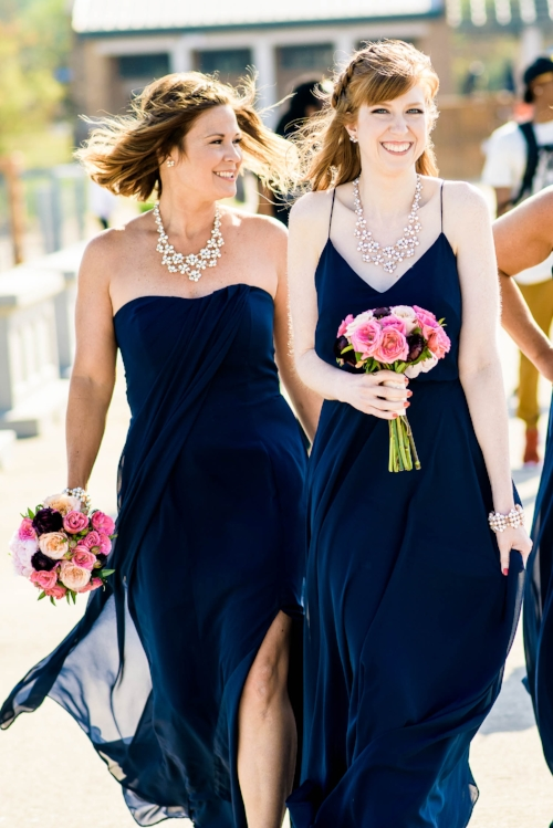 Bridesmaids walk down the 31st Street Beach before a Bridgeport Art Center wedding in Chicago.
