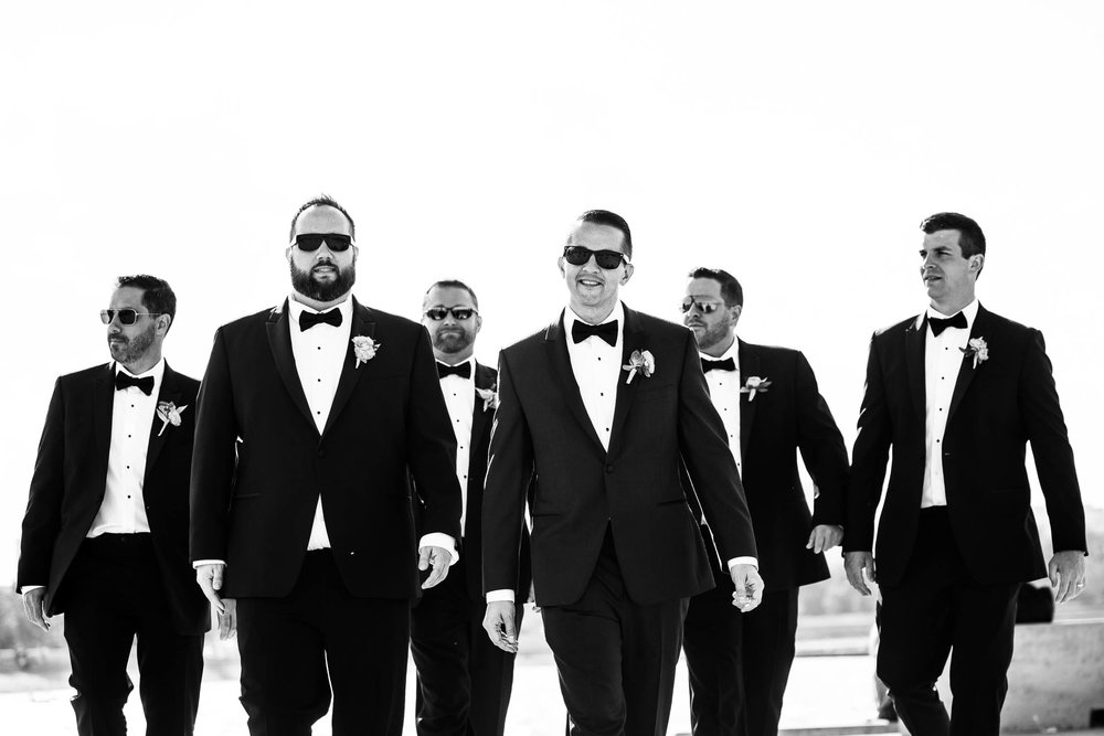 Groomsmen photo at the 31st Street Beach before a Bridgeport Art Center wedding in Chicago.