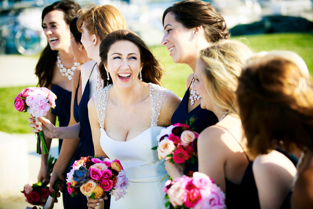Bridesmaids share a laugh at the 31st Beach before a Bridgeport Art Center wedding in Chicago.