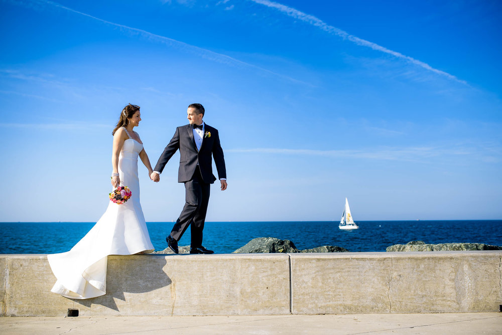 The couple walks along the Lake Michigan shoreline before their Bridgeport Art Center wedding in Chicago.